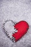 Broken felt heart Stock Images