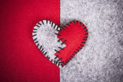 Broken felt heart Stock Images