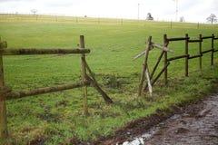Broken fence, animals run away through paddock