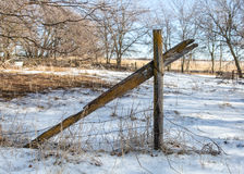 Broken fence post. Weathered animal fencing in a field Royalty Free Stock Images