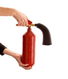 Broken fire extinguisher in the hands Royalty Free Stock Images