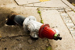 Broken fire hydrant. Lying on the sidewalk Stock Photography