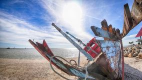 Broken fisherman boat. On the beach in Malaysia Stock Photography