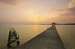 Broken fisherman jetty during sunset Stock Photos