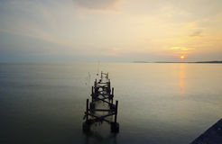 Broken fisherman jetty during sunset Royalty Free Stock Photo