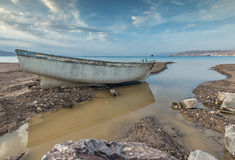 Broken fishing boat after storm Stock Images