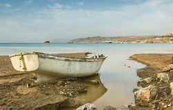 Broken fishing boat after storm Royalty Free Stock Photography