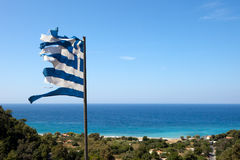 Broken flag of greece in the wind Stock Photography