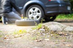 Broken and flat car tyre. Stock Photography