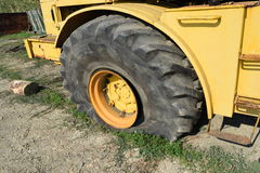 Broken flat tire on a large tractor Stock Image