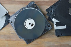 Broken floppy disk on wooden board Royalty Free Stock Photography