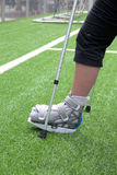 Broken foot, crutches - sports injury Royalty Free Stock Photos