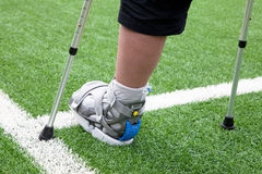 Broken foot, crutches - sports injury Stock Images
