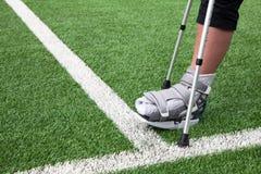 Broken foot, crutches - sports injury Stock Photo