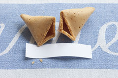 Broken fortune cookie with blank message Stock Image