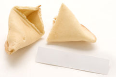 Broken Fortune Cookie with blank Sheet. Royalty Free Stock Photo