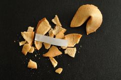 A broken fortune cookie with a piece of paper Stock Images