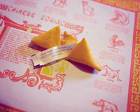 Broken fortune cookie with quote about making opportunities Stock Photography