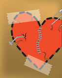 The broken fragmentary heart with a nail. Stock Photography