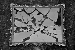 Broken frame. Antique picture frame with broken glass on dirty rag background. Black and white Stock Photography