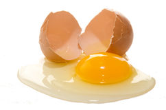 Broken free range egg on white background Royalty Free Stock Photography