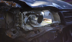 Broken front right car headlight got in an accident Stock Photo