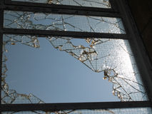 Broken frosted glass window. In a derelict factory Royalty Free Stock Image