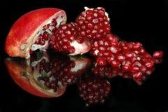 Broken fruit of pomegranate royalty free stock photography