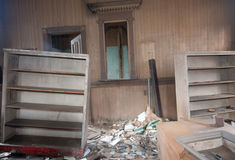 Broken Furniture In A Trashed Room. Trashed room in an old abandoned house Stock Image
