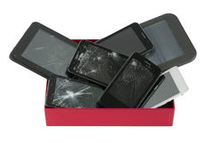 Broken gadgets in red box Royalty Free Stock Photos