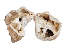 Broken geode with druse of calcite crystals inside on white background. Natural specimen of calcite crystals druse in broken geode from Permian calcareous marl stock image