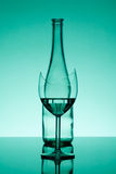 Broken glass. In focus, and a bottle - out of focus Stock Images
