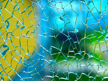 Broken glass. Color background behind the broken glass royalty free stock photos