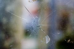 Broken glass. Cracked with hole royalty free stock photos