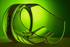 Broken Glass. With dramatic green lighting Stock Image