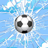 Broken glass. Soccer ball and a crack on the glass Royalty Free Stock Photo