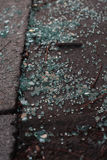 Broken glass. Detail view of broken glass lying on the road royalty free stock photo