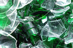 Broken glass. Background of clear and green glass broken into pieces Royalty Free Stock Images