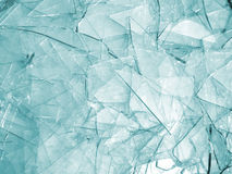 Broken glass. Background of clear glass broken into pieces Stock Photos