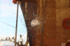 Broken glass. Window broken glass with violence Royalty Free Stock Images