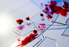 Broken glass. With cutting and dangerous edge after fall with blood (ink) spread over it Stock Photography