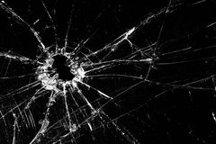 Broken glass. Cracked with hole over black stock photos