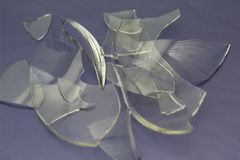The Shards of broken glass close up on a background.  stock photography