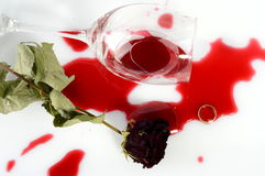 Broken glass after argument. Broken glass, faded rose ant a ring after an argument Stock Images