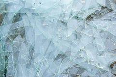 Broken glass on asphalt Royalty Free Stock Photos