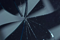 Broken glass. In background black Royalty Free Stock Photo