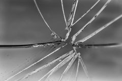 Broken glass. In background blue Royalty Free Stock Image