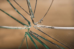 Broken glass. In background orange Royalty Free Stock Images