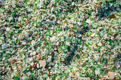 Broken glass at beach substitute sand Stock Photography