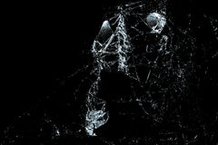 Broken Glass On A Black Background Stock Image